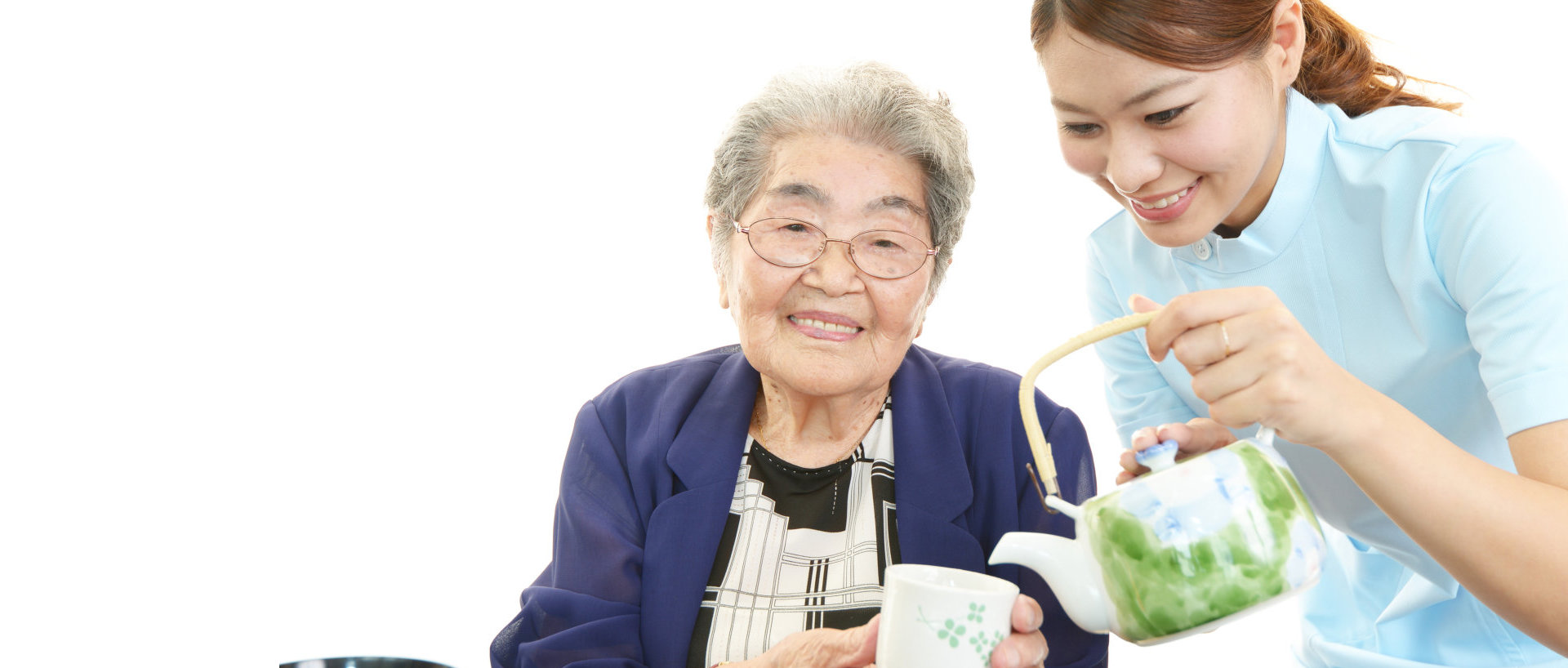 caregiver pouring a tea to patient's cup
