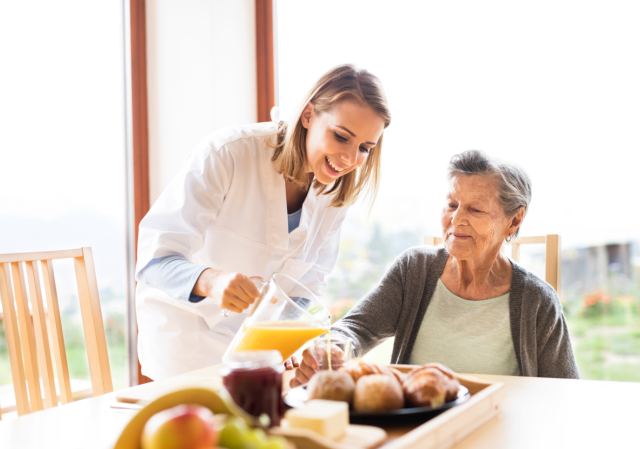 Caregiver serving healthy foods