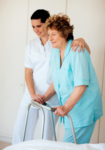 Caregiver assisting an elderly to walk