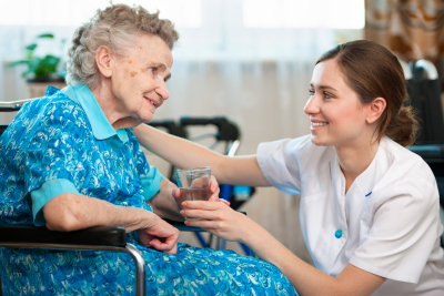 elder woman with caregiver smiling