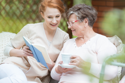 woman and elder woman reading