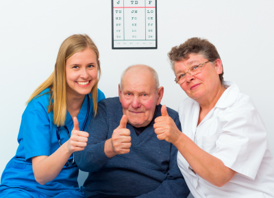 two caregivers with elder