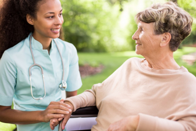 senior woman and caregiver looking to each other