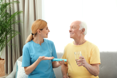 senior man and caregiver talking