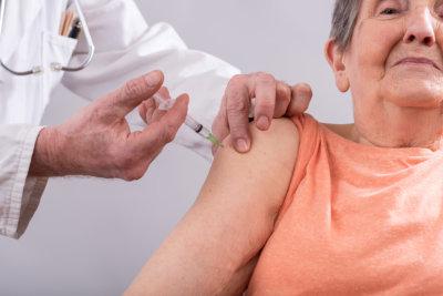 senior lady getting a vaccine shot